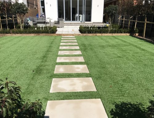 Artificial grass with sawn Sandstone steps